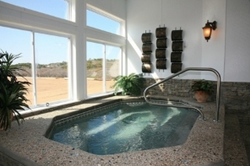 Indoor pool and hot tub with a slide  Cape Cod Indoor Pool